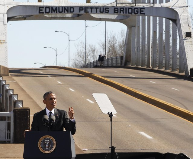 U.S. President Barack Obama speaks at the foot of the Edmund Pettus Bridge in Selma, Alabama March 7, 2015. With a nod to ongoing U.S. racial tension and attempts to limit voting rights, Obama declared the work of the Civil Rights Movement advanced but unfinished on Saturday on a visit to the Alabama bridge that spawned a landmark voting law.  REUTERS/Tami Chappell  (UNITED STATES - Tags: POLITICS ANNIVERSARY SOCIETY)