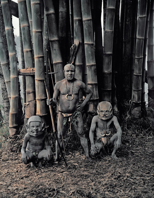 """""""Asaro from the Eastern Highlands"""". The mudmen could not cover their faces with mud because the people of Papua New Guinea thought that the mud from the Asaro river was poisonous. So instead of covering their faces with this alleged poison, they made masks from pebbles that they heated and water from the waterfall, with unusual designs such as long or very short ears either going down to the chin or sticking up at the top, long joined eyebrows attached to the top of the ears, horns and sideways mouths. (Jimmy Nelson)"""