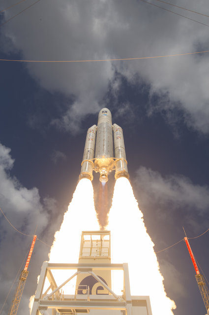 This November 17, 2016 photo shows the liftoff of Ariane flight VA233, carrying four Galileo satellites, from Europe's Spaceport in Kourou, French Guiana. Europe's Galileo satellite navigation system, designed to rival the U.S.-made GPS service, has begun formal operations. The European Space Agency, ESA, said Thursday, Dec. 15, 2016, that 18 Galileo satellites already in orbit will be joined by another 12 in the coming years to ensure an uninterrupted service. (Photo by Stephane Corvaja/ESA via AP Photo)