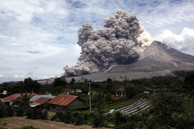 Mount Sinabung releases pyroclastic flows seen from Tiga Serangkai, North Sumatra, Indonesia, Wednesday, April 1, 2015. (Photo by Binsar Bakkara/AP Photo)