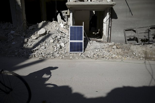 A solar panel is placed on rubble along a street in the Douma neighbourhood of Damascus, Syria February 9, 2016. (Photo by Bassam Khabieh/Reuters)