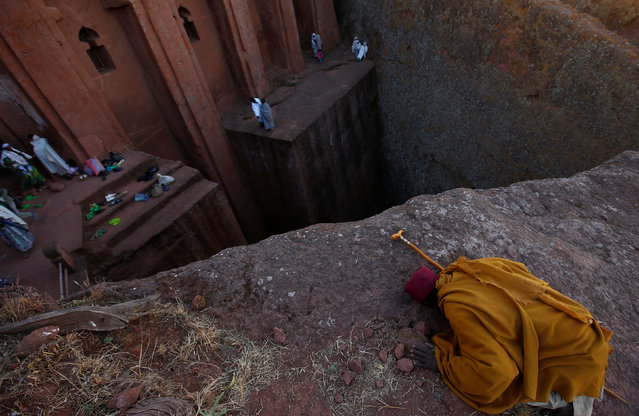 An Ethiopian Orthodox monk prays within a rock hewn church ahead of Ethiopian Christmas in Lalibela, January 6, 2017, which is celebrated on January 7. (Photo by Tiksa Negeri/Reuters)