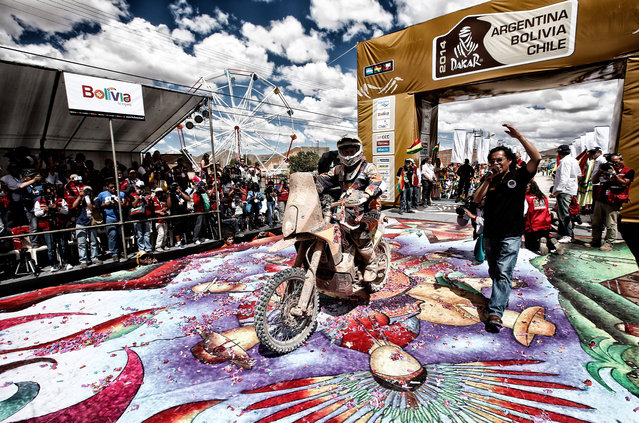 (#2) Marc Coma of Spain for the KTM Red Bull Rally Factory Team makes his way off the podium during Day 8 of the 2014 Dakar Rally on January 12, 2014 in Uyuni, Bolivia. (Photo by Dean Mouhtaropoulos/Getty Images)