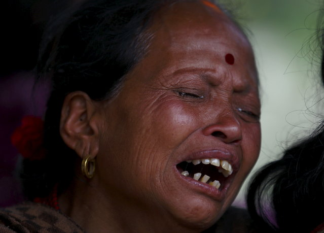 A woman mourns the death of a family member a day after an earthquake in Bhaktapur, Nepal April 26, 2015. (Photo by Navesh Chitrakar/Reuters)