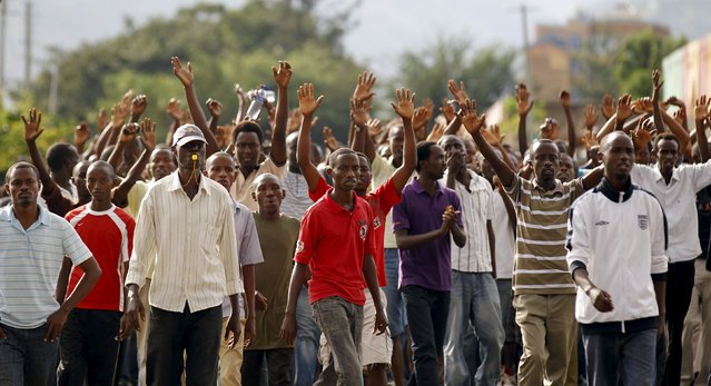 Residents participate in street protests against the decision made by Burundi's ruling National Council for the Defence of Democracy-Forces for the Defence of Democracy (CNDD-FDD) party to allow President Pierre Nkurunziza to run for a third five-year term in office, in the capital Bujumbura, April 26, 2015. (Photo by Thomas Mukoya/Reuters)