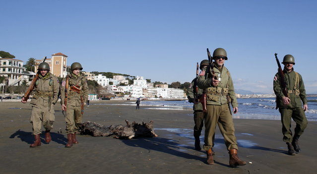 Volunteers wearing the uniform of the U.S. army patrol as they participate in the re-enactment of a World War Two landing to mark its 70th anniversary in Anzio, near Rome, January 25, 2014. (Photo by Stefano Rellandini/Reuters)