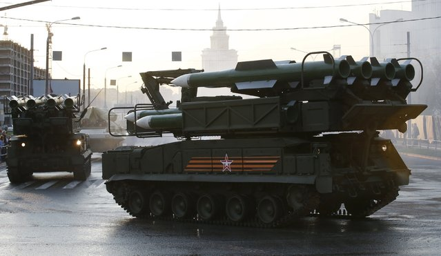 Buk surface-to-air missile systems (front) drive along a street before a rehearsal for the Victory Day parade in Moscow, Russia, April 29, 2015. (Photo by Maxim Zmeyev/Reuters)