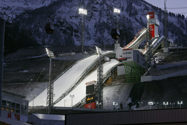 The ski jumping venue of the 2014 Winter Olympics is illuminated, Monday, February 3, 2014, in Krasnaya Polyana, Russia. (Photo by Dmitry Lovetsky/AP Photo)
