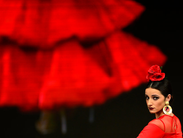 A model presents a creation by Pilar Vera during the SIMOF 2017 (International Flamenco Fashion) in Sevilla on February 2, 2017. (Photo by Cristina Quicler/AFP Photo)