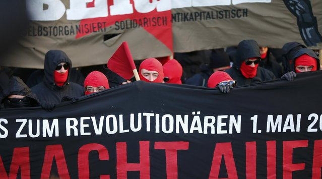 Masked protestors walk during a May Day march through Berlin's Kreuzberg district, Germany, May 1, 2015. (Photo by Hannibal Hanschke/Reuters)