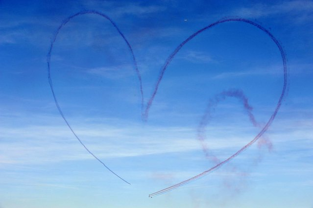 Alphajet aircraft draw a heart-shaped message in the sky during the 2010 presentation show of the French aerobatics team Patrouille de France, over the French city of Salon-de-Provence. (Photo by Gerard Julien/AFP Photo)