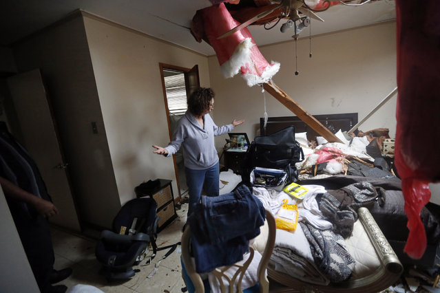 Artie Chaney reacts to her damaged home after a tornado struck while she and family members took cover inside, in the eastern part of New Orleans, Tuesday, February 7, 2017. (Photo by Gerald Herbert/AP Photo)