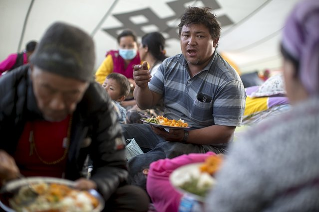 Lhakpa Jangpa, 34, an earthquake survivor from Kyanjin Gumba in Langtang valley near Nepal's border with Tibet, talks to his friends at Yellow Gompa in Kathmandu, Nepal, May 5, 2015. Rescue workers are struggling to recover the bodies of nearly 300 people, including about 110 foreigners, believed to be buried under up to six metres (20 feet) of ice, snow and rock from the landslide that destroyed Langtang village. (Photo by Athit Perawongmetha/Reuters)
