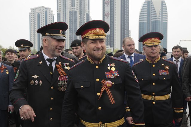 Chechen regional leader Ramzan Kadyrov, center, wearing a Russian military uniform, attends celebrations marking the 70th anniversary of the victory over Nazi Germany, in Chechnya's provincial capital Grozny, Russia, Saturday, May 9, 2015. (Photo by Musa Sadulayev/AP Photo)