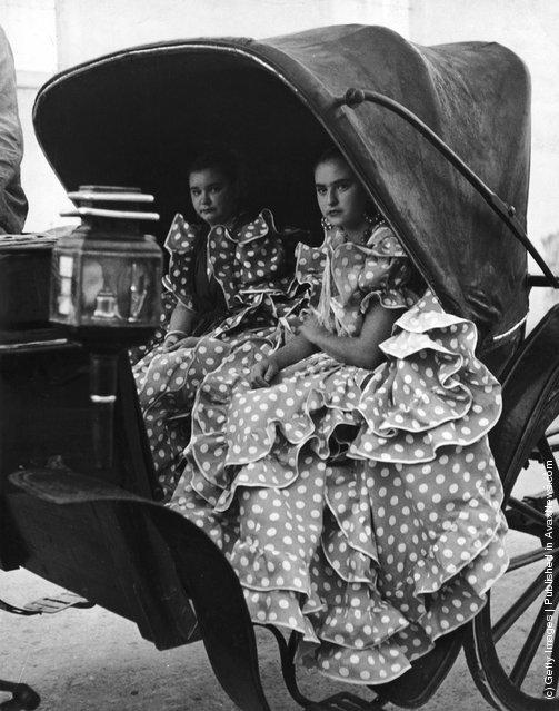 Two girls in polka dot flamenco dresses