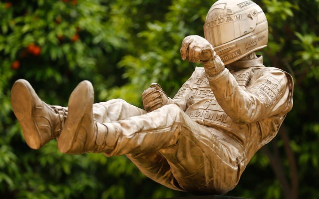 A bronze sculpture by British artist Paul Oz depicting late Brazilian Formula One driver Ayrton Senna is unveiled during a ceremony in Barcelona on May 8, 2019 to mark the 25th anniversary of his death. The Brazilian icon died after a crash at the San Marino GP at the Imola circuit on May 1, 1994 at the age of just 34. (Photo by Pau Barrena/AFP Photo)