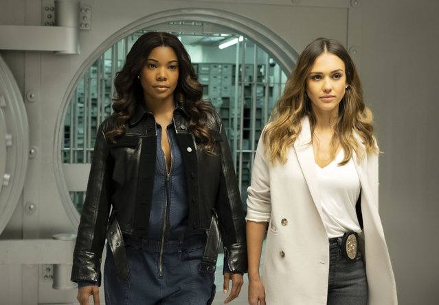 "This image released by Spectrum Originals dhows Gabrielle Union, left, and Jessica Alba in a scene from ""L.A.'s Finest"". Union and  Alba star in and produce the new police detective series premiering May 13. (Photo by Erica Parise/Spectrum Originals via AP Photo)"
