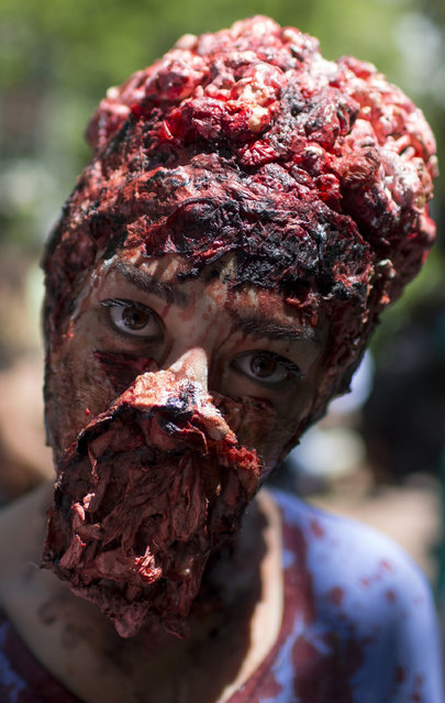 A participant poses during the Istanbul Zombie Walk in Nisantasi Park, in Istanbul, Turkey, 10 May 2015. (Photo by Sedat Suna/EPA)