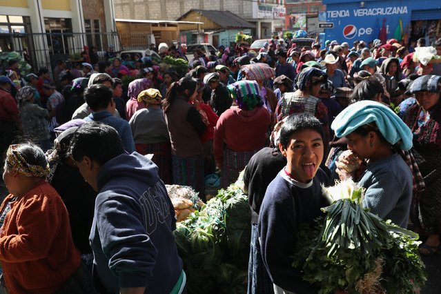 """Buyers and sellers crowd into a vegetable market on February 11, 2017 in Almolonga, Guatemala. The Mayan town in the western highlands district of Quetzaltenango has surged in prosperity in recent years with high-productivity vegetable farming, exporting much of its excess crops to neighborning El Salvador. Almolonga has been called the """"Vegetable Basket of the Americas"""". Many locals attribute the town's change in fortunes to the rapid growth of the Evangelical Christian faith in the area, while others credit the increased use of pesticide farming. Regardless, the strong local economy will be key maintaining the town's prosperity if the Trump Administration follows through on curtailing remittance money sent back from undocumented immigrants in the U.S. to their families in Guatemala. (Photo by John Moore/Getty Images)"""