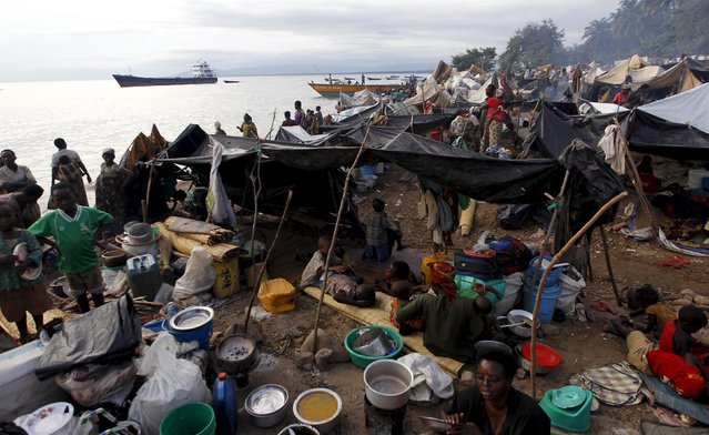 A general view shows Burundian refugees as they prepare food within their makeshift shelters while they gather on the shores of Lake Tanganyika in Kagunga village in Kigoma region in western Tanzania, to wait for MV Liemba to transport them to Kigoma township, May 17, 2015. (Photo by Thomas Mukoya/Reuters)