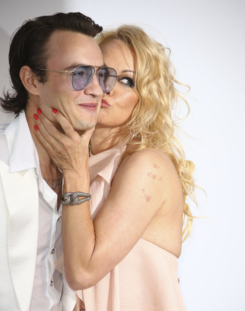 Actress Pamela Anderson, right, kisses her son Brandon Thomas Lee as they pose for photographers upon arrival at the amfAR, Cinema Against AIDS, benefit at the Hotel du Cap-Eden-Roc, during the 72nd international Cannes film festival, in Cap d'Antibes, southern France, Thursday, May 23, 2019. (Photo by Joel C. Ryan/Invision/AP Photo)