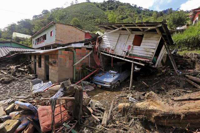 Destroyed houses are seen after a landslide sent mud and water crashing onto homes close to the municipality of Salgar in Antioquia department, Colombia May 19, 2015. (Photo by Jose Miguel Gomez/Reuters)