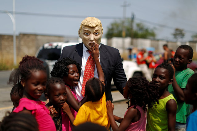 An activist wearing a mask depicting U.S. President Donald Trump participates in a protest outside the premises of the National Migration Institute (INM) in Tapachula, Mexico April 6, 2019. (Photo by Jose Cabezas/Reuters)