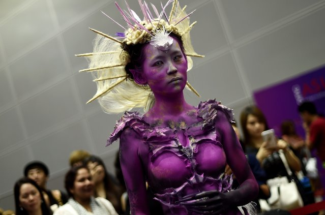 A model poses during a hairstyling and make-up competition in Kuala Lumpur on May 18, 2015. (Photo by Manan Vatsyayana/AFP Photo)