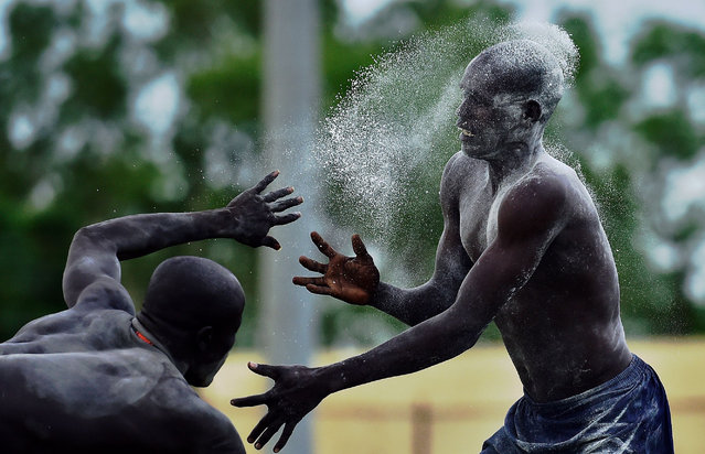 South Sudanese wrestlers take part in a wrestling match for peace in Juba on April 19, 2016. The last wrestling match for peace was held in Juba the day before civil war broke out in December 2013. (Photo by Carl de Souza/AFP Photo)