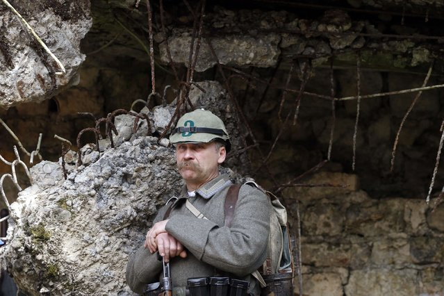Franz, a member of a German World War I historical association, stands in front of a heavy artillery bunker during walk through the national forest of Verdun. (Photo by Charles Platiau/Reuters)