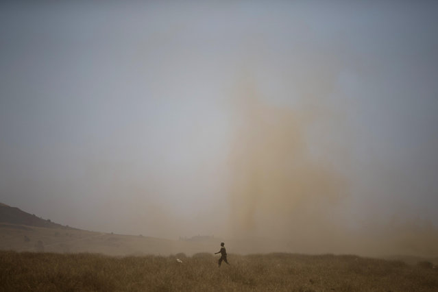 An Israeli soldiers walks during a training exercise in the Israeli-occupied Golan Heights, near the border with Syria, Wednesday, June 17, 2015. Syrian rebels launched a wide-ranging offensive against Syrian government positions near the Golan Heights on Wednesday, after tit-for-tat shelling in and around Damascus left at least 33 people dead, activists said. Insurgents have been on the offensive in southern Syria for the past three months, capturing military bases, villages and a border crossing point with Jordan. (AP Photo/Ariel Schalit)