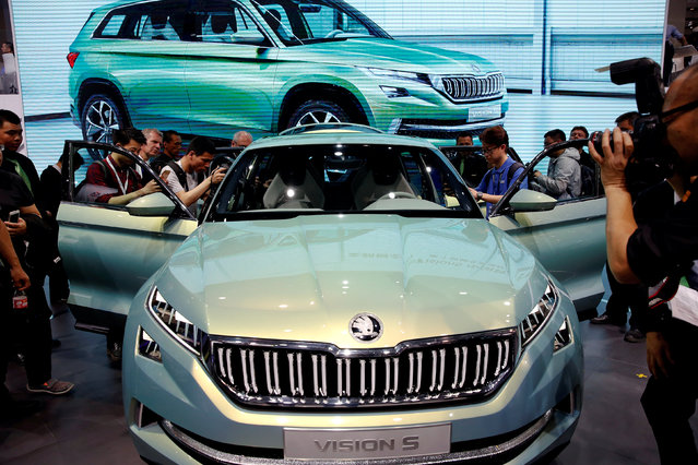 Visitors gather around a Skoda Vision S presented at the Auto China 2016 show in Beijing, China April 25, 2016. (Photo by Damir Sagolj/Reuters)