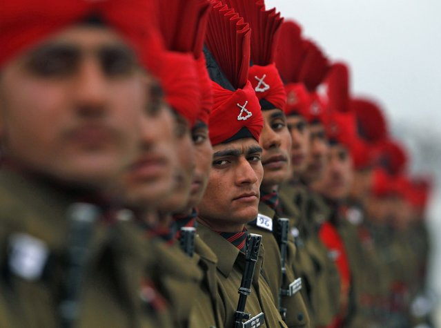 Indian army recruits take part in their passing out parade at a garrison in Rangreth on the outskirts of Srinagar April 5, 2014. Authorities said that 311 young Kashmiri men of various religious backgrounds were formally inducted into the Indian army's Jammu and Kashmiri Light Infantry Regiment (JKLIR) after their 49 weeks of training. (Photo by Danish Ismail/Reuters)