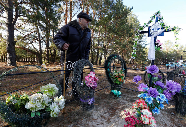 Ivan Shamyanok, 90, visits his brother's grave at a cemetery in the village of Tulgovichi, near the exclusion zone around the Chernobyl nuclear reactor, Belarus April 3, 2016. The 30th anniversary of the disaster has shone a new light on the long-term human impact of the worst nuclear meltdown in history. The official short-term death toll from the accident was 31 but many more people died of radiation-related illnesses such as cancer. The total death toll and long-term health effects remain a subject of intense debate. (Photo by Vasily Fedosenko/Reuters)