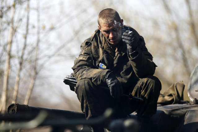 A Ukrainian soldier smokes a cigarette as he sits on an airborne combat vehicle near Kramatorsk, in eastern Ukraine April 16, 2014. (Photo by Marko Djurica/Reuters)
