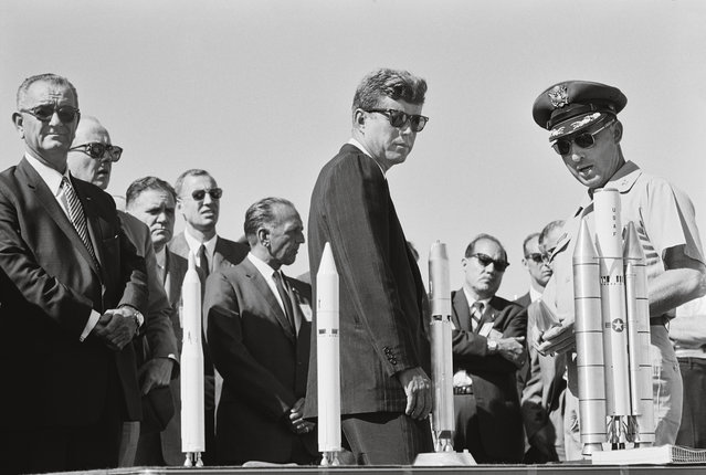 John F Kennedy, centre, and the US vice-president, Lyndon Johnson, far left, visit Huntsville in September 1962 to check on Nasa's progress during a cross-country tour of American space facilities. In May the previous year, Kennedy set forth the priority of landing a man on the moon by the end of the decade and returning him safely to Earth. (Photo by Bob Gomel/Time & Life Pictures/Getty Images/Tasche)
