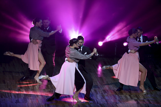 Couples dance during a show prior to the finals of the Salon category at the annual Tango Dance World Championship in Buenos Aires, Argentina, Tuesday, August 20, 2019. (Photo by Natacha Pisarenko/AP Photo)