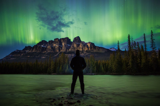 A landscape photographer turned the camera on himself to take a set of incredible selfie while visiting some of the world's most beautiful destinations. Paul Zizka, 39, from Alberta, Canada, has been a photographer for nine years, and thought that featuring in his own pictures would emphasize the nature surrounding him and create a more unique shot. The creative snapper has taken pictures of himself while camping on the Greenland ice cap, crossing the Antarctic Circle, standing under the Milky Way in the Gobi Desert and, most recently, at Wapta Falls in Yoho National Park, Canada. While all are self-portraits, none are traditional selfies taken while holding the camera; he uses the equipment's self-timer mode before walking into the frame. Here: Aurora in the Canadian Rockies. (Photo by Paul Zizka/Caters News Agency)