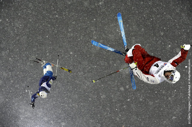 Denis Dolgodorov of Russia and Mikael Kingsbury of Canada compete during the FIS Freestyle Ski World Cup Dual Moguls