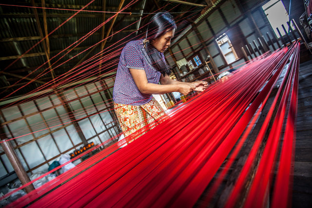 """Patience"". Woman making red thread. When I saw her I took my camera and started shooting from different angles. She was so concentrated and worked with such a patience that amazed me. Photo location: Inle Lake, Myanmar. (Photo and caption by Lenart Gonzalez/National Geographic Photo Contest)"