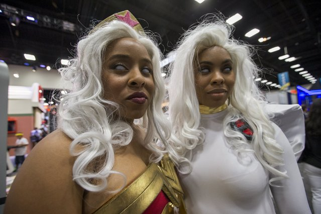 Cosplay enthusiasts Liz (L) and Ruth wear costumes resembling Wonder Woman and Storm from the X-Men, during the 2015 Comic-Con International Convention in San Diego, California July 10, 2015. (Photo by Mario Anzuoni/Reuters)