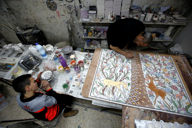 Palestinians paint ceramics in Al-Okhowa pottery shop in the West Bank city of Hebron February 9, 2017. (Photo by Mussa Qawasma/Reuters)