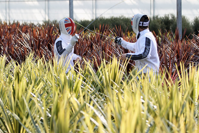 Great Britain fencers Ben Peggs and Marcus Mepstead pose aduring the Beazley British Fencing Horticultural Photo Shoot at Hillier Nursery, Ampfield