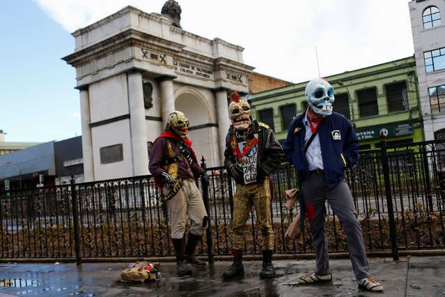 Demonstrators wear skull masks during an anti government protest, as Chile's President Michelle Bachelet delivers a speech inside the National Congress, in Valparaiso city, Chile May 21, 2016. (Photo by Ivan Alvarado/Reuters)
