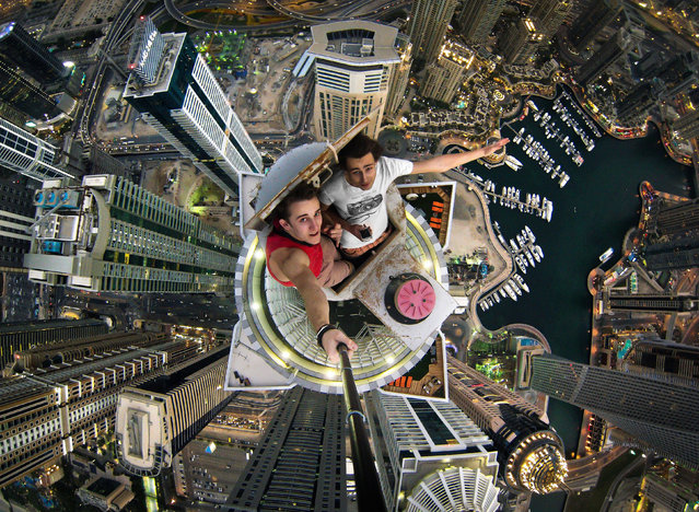 Daredevils, Alexander in red and Volodya in whitetaking a selfie over Dubai. (Photo by Alexander Remnev/Caters News)