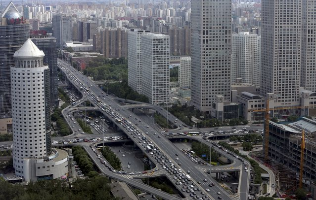 Vehicles drive on the Guomao Bridge through Beijing's central business district, June 11, 2015. The World Bank said on July 1, 2015, it expects China's economy to grow 7.1 percent this year, the same as forecast earlier, before cooling to 7.0 percent next year and 6.9 percent in 2017. (Photo by Jason Lee/Reuters)