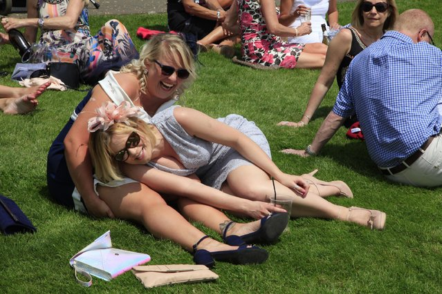 Race goers are pictured during the Investec Ladies Day at Epsom Downs Racecourse on June 2, 2017 in Epsom, England. (Photo by Alamy Stock Photos)