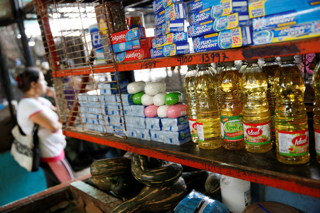 Bottles of cooking oil that are made in Colombia are displayed at a stall that sells food and staple items at a market in La Fria, Venezuela, June 2, 2016. (Photo by Carlos Garcia Rawlins/Reuters)