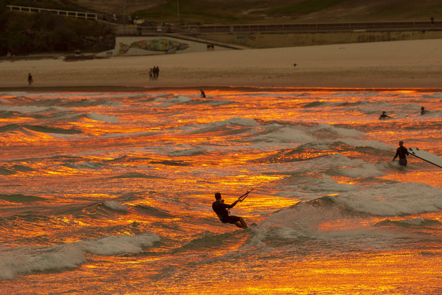 A hazy red sun sets over Bondi Beach on December 19, 2019 in Sydney, Australia. NSW Premier Gladys Berejiklian has declared a state of emergency for the next seven days with ongoing dangerous fire conditions and almost 100 bushfires burning across the state. It's the second state of emergency declared in NSW since the start of the bushfire season. (Photo by Jenny Evans/Getty Images)