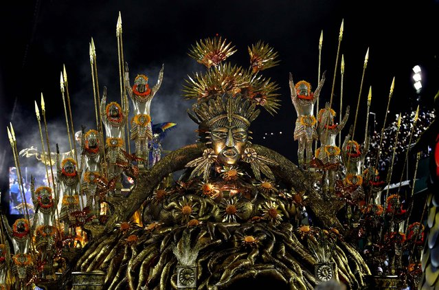 Performers from the Beija Flor samba school join the celebrations at the Sambadrome in Rio de Janeiro